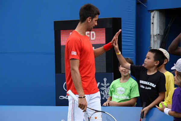 Novak Djokovic Giving a High Five to Gabriel